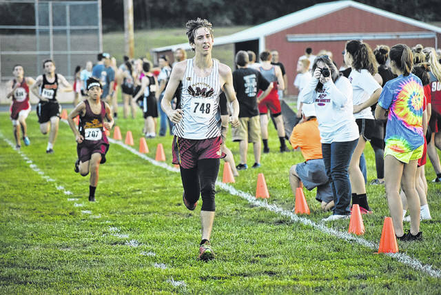 Meigs' Christian Jones strides toward finish line at the  at the Federal Hocking Invitational on Sep. 19 in Stewart, Ohio. (Scott Jones|OVP Sports)