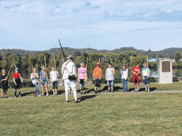 Local students from last year's Battle Days festival learning about musketry.