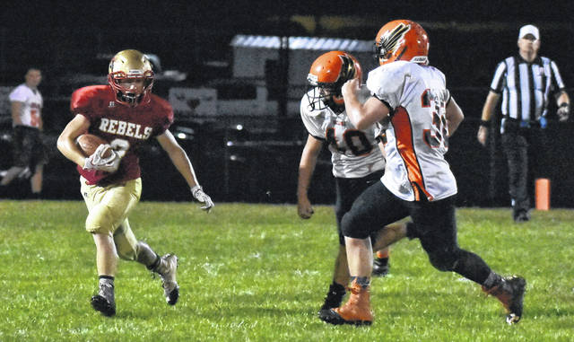 SGHS junior Jared Ward carries the ball during the Rebels 50-31 setback to Belpre on Friday night in Gallia County.