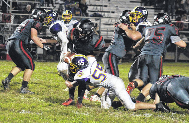 Southern senior Ryan Mills (55) sacks Red Devils quarterback Max Hilton, during the Tornadoes' 35-19 victory on Friday in Ravenswood, W.Va.