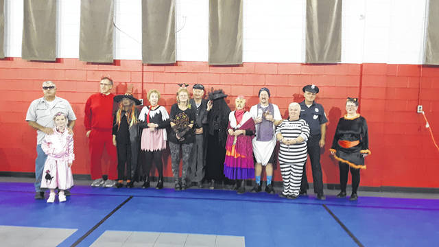 The Belles and Beaus square dance club members, along with their guests recently held their annual Halloween party in Cheshire, Ohio. Some of the members dressed up in costumes. Shown here are the members who participated in the competition. Prizes were awarded for their efforts. The evening also included a pot luck meal and square dance lessons. A fun filled evening was enjoyed by all.