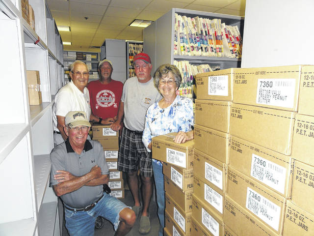 Elk's members Bill Johnson, Fred Bryant, Gary Rife and Ron Jackson along with Snack Pack representative Nancy Blevins are shown at the Snack Pack Distribution Center at the Holzer facility on State Rt. 850 where the snack packs are filled.