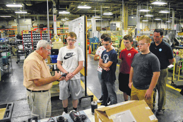 Electrocraft engineer Ed Swisher, left, discusses job opportunities in the manufacturing world with Gallia Academy High School students.