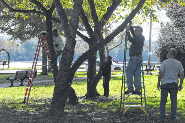 Gallipolis in Lights volunteers lace trees in Gallipolis City Park with lights in preparation for the annual lighting ceremony, Nov. 21.