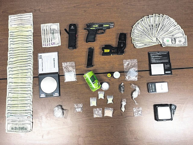 After completing a search of a hotel room, officers located a large quantity of methamphetamine, heroin, prescription medications and marijuana. Officers also reportedly seized a large quantity of money, a 9 mm handgun and a X26 Taser along with digital scales.
