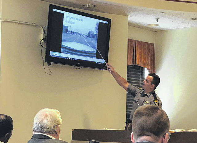 Ohio State Highway Patrol Trooper James Trelka demonstrates evidence points in dash cam footage in the Gallia Court of Common Pleas.