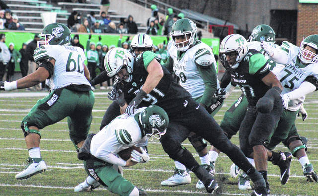 MU senior Ryan Bee (91) sacks UNCC quarterback Evan Shirreffs, during the second half of Marshall's 17-point victory on Saturday at Joan C. Edwards Stadium in Huntington, W.Va.
