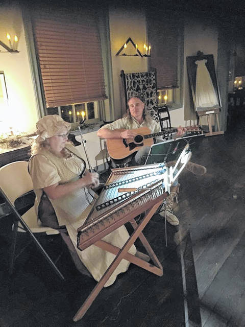 Musicians Kendra Ward and Robert Bence play Christmas music on hammered dulcimer and guitar. The duo returns for the Our House Tavern open house event held in conjuction with the Gallipolis In Lights Park Lighting on Wednesday, Nov. 21.