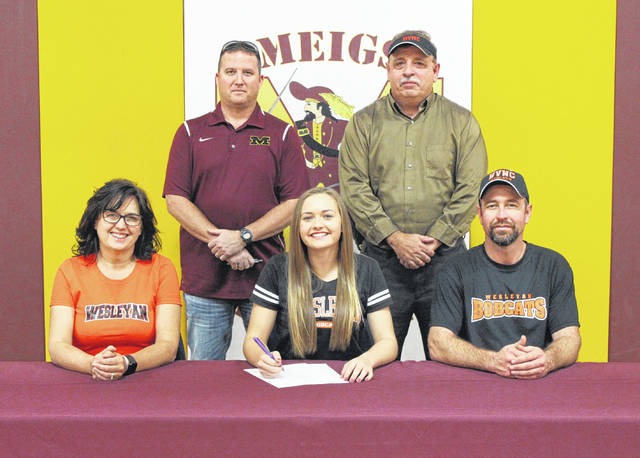 On Nov. 16 at MHS, senior Taylor Swartz signed her National Letter of Intent to join the West Virginia Wesleyan softball team. Sitting in the front row, from left, are Dee Swartz, Taylor Swartz and Toby Swartz. Standing in the back row are MHS athletic director Kevin Musser and Lady Marauders head coach Bryan Swann.