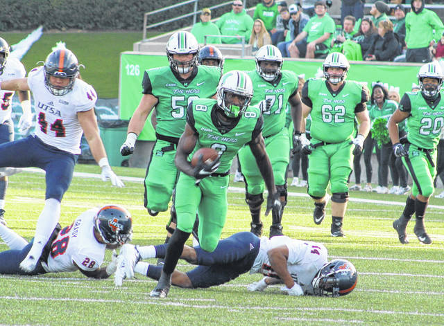 Marshall wideout Tyre Brady (8) breaks away from a pair of Texas San Antonio defenders during a Nov. 17 football contest at Joan C. Edwards Stadium in Huntington, W.Va.