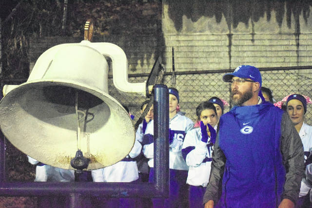 Second-year GAHS football coach Alex Penrod talks to the home crowd by the victory bell after the Blue Devils defeated South Point in Week 10 for the program's first-ever OVC championship at Memorial Field in Gallipolis, Ohio.