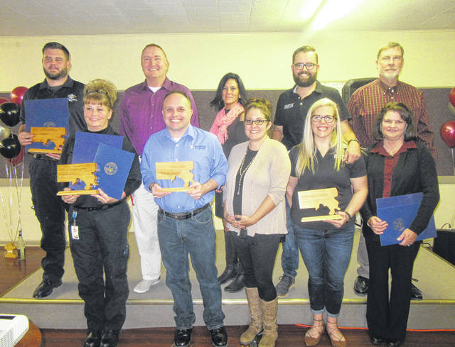 Award recipients at the 2018 Meigs County Chamber of Commerce Awards Gala included, from left, Jack Lemley and Le'Anna Davis from Meigs EMS, Bruce Wolfe and Dan Dunham from Wolfe Mountain Entertainment, Chamber ambassadors Jennifer Doczi and Heather Evans, Brandon and Rana Bartee of Bartee Photography, and Tim and Martie Baum of Baum Lumber.