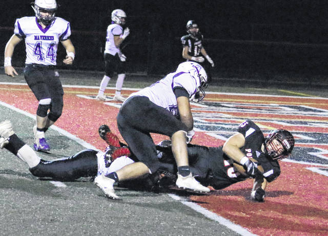 Point Pleasant senior James Musgrave (13) falls into the end zone for a touchdown during the second half of Friday night's football contest against James Monroe at OVB Field in Point Pleasant, W.Va.