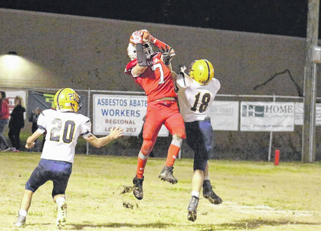 Wahama senior Tanner Smith (7) makes a leaping grab in double coverage, during the White Falcons' season finale on Friday in Mason, W.Va.