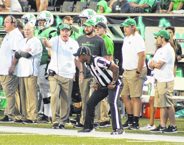 Marshall head coach Doc Holliday disputes a call during a Sept. 8 football game against Eastern Kentucky at Joan C. Edwards Stadium in Huntington, W.Va.