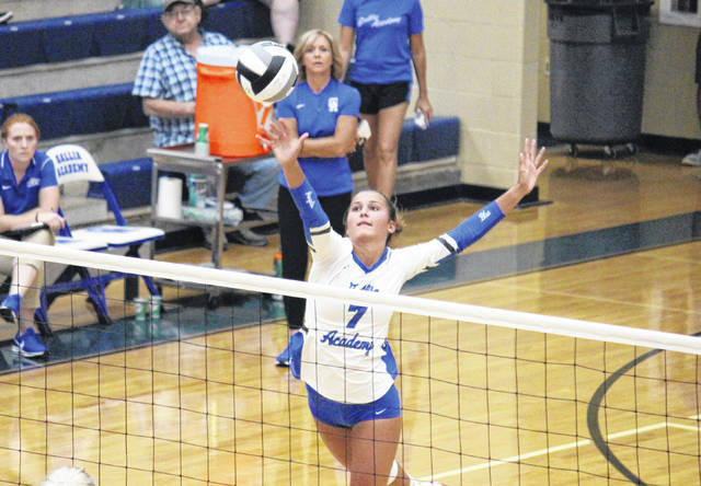 Gallia Academy junior Peri Martin (7) hits the ball over the net, during the Blue Angels' victory on Aug. 28 in Centenary, Ohio.