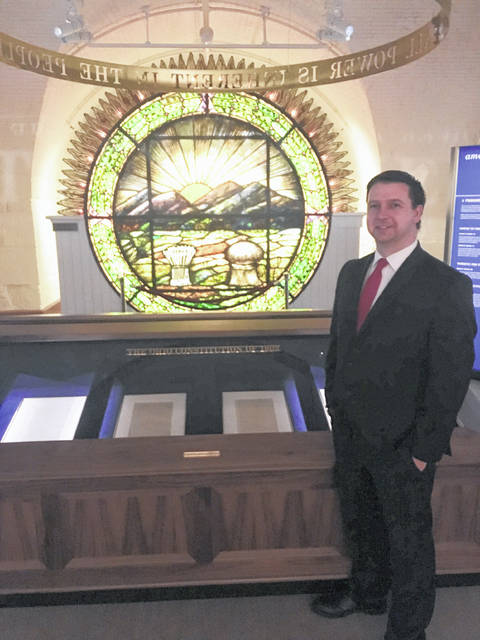 Meigs County Prosecutor James K. Stanley is pictured with the original Ohio Constitution of 1802.