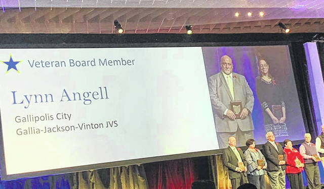 Lynn Angell is recognized for 25 years as a board of education member.