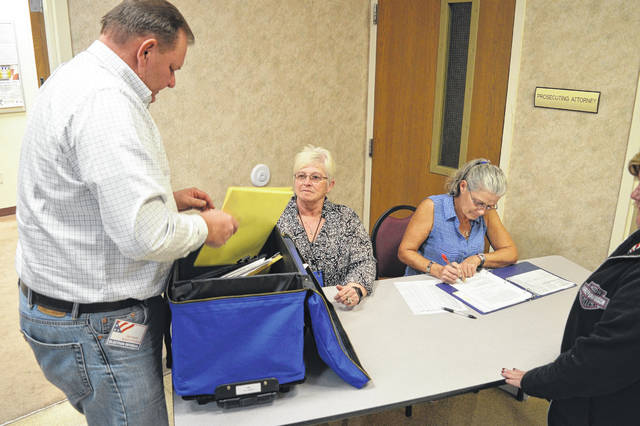Gallia Election Day workers organize paperwork as results come to the Gallia Board of Elections.