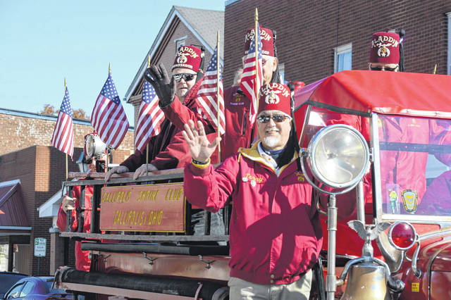 Gallipolis Shriners wave as they drive by.