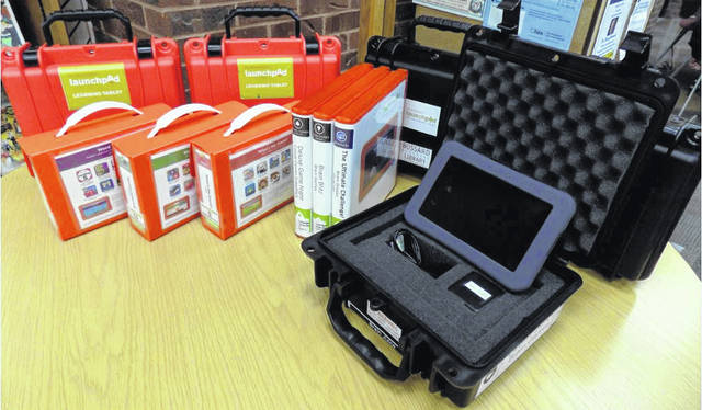 Bossard Library recently added five adult-level tablets to their existing collection of Launchpad tablets. Any adult patron in good standing can check out a Launchpad free with their Bossard Library card. The adult-level Launchpads are pictured in black cases.