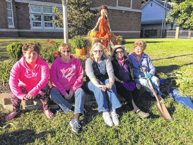 Gallipolis Garden Club members have a civic project of planting and maintaining the gardens at Washington Elementary school. Seen are some of the members that recently cleaned the gardens and got them ready for fall.