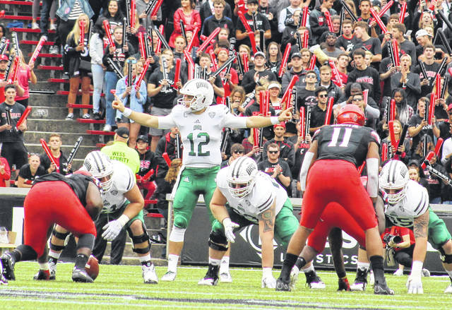Ohio quarterback Nathan Rourke (12) calls a play from the line of scrimmage during a Sept. 22 football contest against the Cincinnati Bearcats at Nippert Stadium in Cincinnati, Ohio.