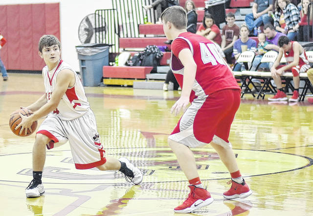 SGHS senior Garrett Saunders (4) attempts to pass during the Rebels 70-68 victory over Symmes Valley on Friday night in Mercerville, Ohio.