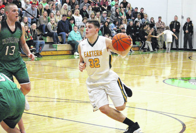 Eastern senior Isaiah Fish (32) drives to the basket, during the Eagles' 45-30 setback on Tuesday in Tuppers Plains, Ohio.