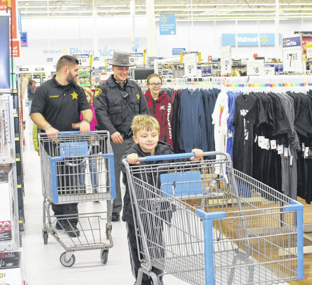 A total of 65 kids were joined by first responders, law enforcement and others to shop on Friday morning.
