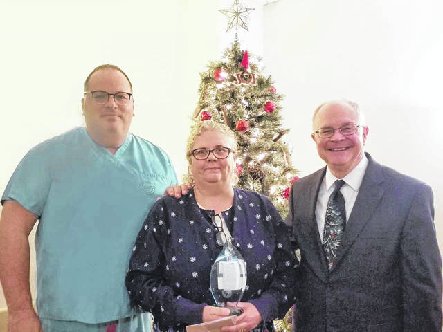 Pleasant Valley Hospital Employee of the Year Beverly Mattox, pictured at center, along with Ryan Henry, chief of anesthesia and director of surgical services, at left, and Glen Washington, FACHE, PVH CEO.
