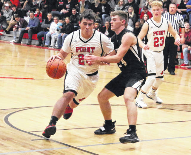 Point Pleasant junior Braxton Yates dribbles past a River Valley defender during the second half of a Dec. 11 boys basketball contest at The Dungeon in Point Pleasant, W.Va.