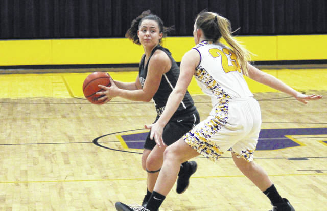 River Valley senior Cierra Roberts (left) is guarded by Southern junior Shelby Cleland (23), during the Lady Raiders' 29-point victory on Saturday in Racine, Ohio. (Alex Hawley|OVP Sports)