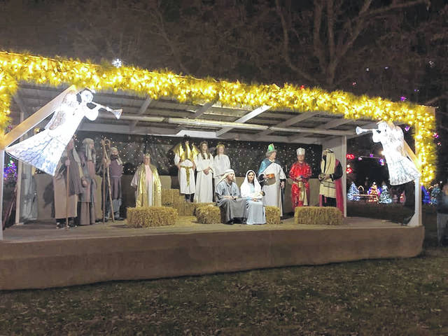 Members of the First Church of the Nazarene in Gallipolis recreate the nativity earlier this week in Gallipolis City Park. Many local churches will be hosting their own live nativity events throughout the season as a part of Gallipolis in Lights.