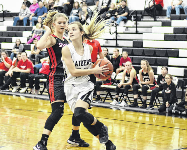 RVHS junior Kaylee Gillman (30) drives along the baseline during the Lady Raiders 72-10 setback to Alexander on Monday night in Bidwell, Ohio.