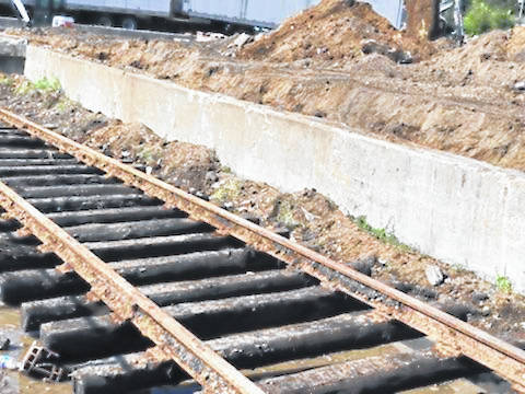 Railroad tracks were revealed under the ground during the demolition of the old Willis Tire facility.