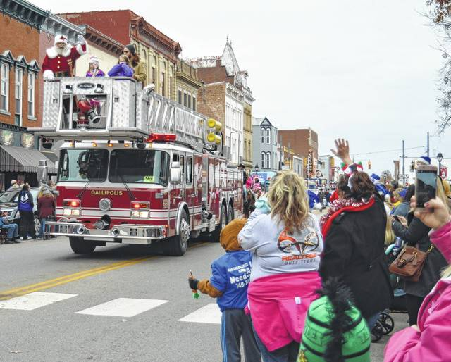 Santa Claus has long ridden on a firetruck as part of Gallipolis Christmas tradition.