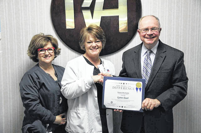 Lynn Curl is pictured at center, along with Karen Meadows, director of quality & accreditation, and Glen Washington, FACHE, PVH CEO.