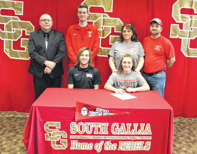 South Gallia senior Jessica Luther, seated right, will be continuing both her cross country and track and field careers after signing with Kentucky Christian University on Tuesday, Jan. 8, 2019, inside the SGHS library in Mercerville, Ohio. Luther is joined at the table by KCU coach Chuck Wentz. Standing in back, from left, are SGHS athletic director Kent Wolfe, SGHS track and cross country coach Marcus Meyers, and parents Dafney Davis and Mike Davis.