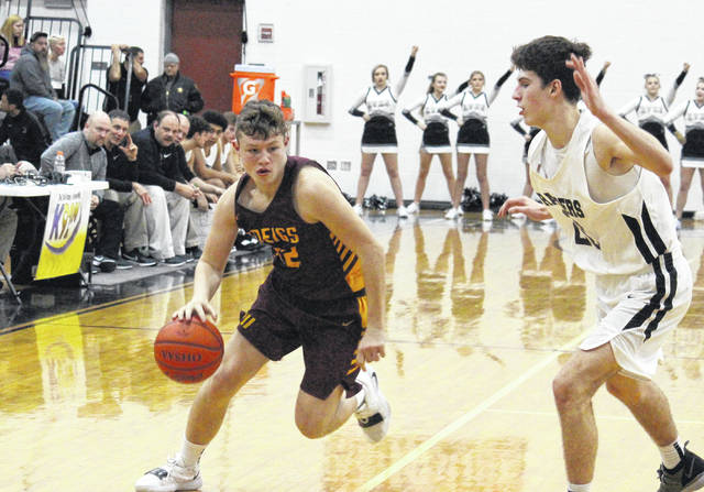 Meigs sophomore Wyatt Hoover (left), drives past River Valley sophomore Jordan Lambert (right), during the Marauders' 84-33 victory on Friday in Bidwell, Ohio.
