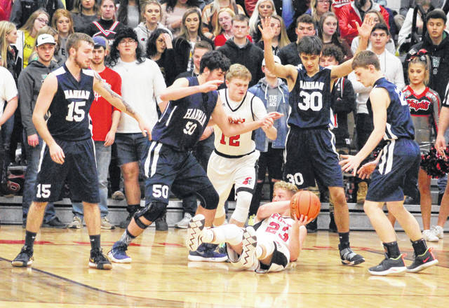 Point Pleasant's Hunter Bush (23) retrieves a loose ball while being surrounded by Hannan defenders Chase Nelson (15), Chandler Starkey (50), Casey Lowery (30) and Ryan Hall, right, during the first half of Friday night's boys basketball contest in Point Pleasant, W.Va.
