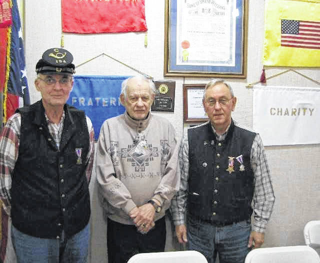 Pictured from left, are, David Carter, assistant chaplain, David R. Johnson, member, and James Oiler, commander.