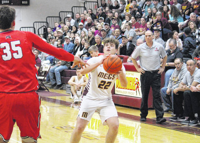Meigs senior Nick Lilly (22) pulls up for a three-pointer, during the Marauders' 54-41 loss to Alexander on Friday in Rocksprings, Ohio.