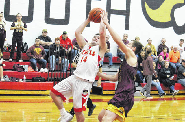 South Gallia senior Nick Hicks (14) goes in for a layup, during the Rebels' win over Federal Hocking on Dec. 14, 2018, in Mercerville, Ohio.