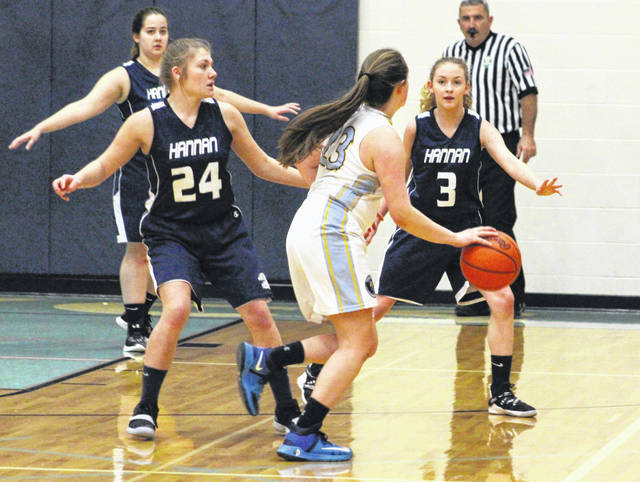 Hannan defenders Halie Johnson (24) and Madison Gill (3) apply pressure to Ohio Valley Christian's Kristen Durst during the second half of Tuesday night's girls basketball contest in Gallipolis, Ohio.