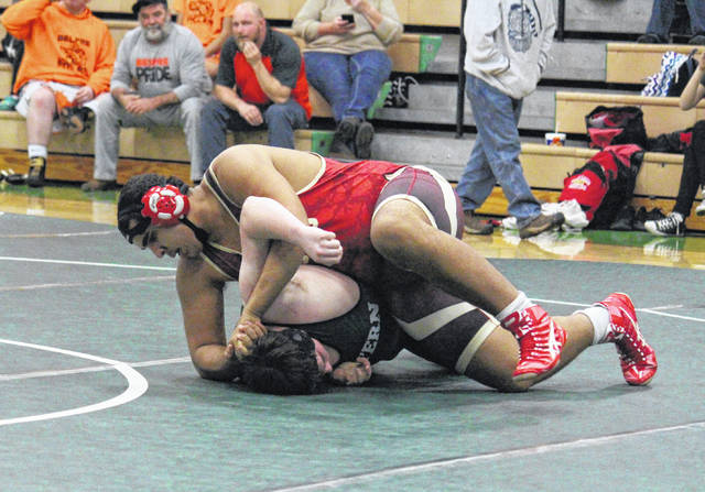 South Gallia senior Tanner Dennison flips an EHS opponent on to his back, during a heavyweight bout, on Wednesday in Tuppers Plains, Ohio.