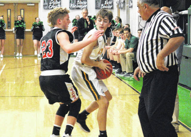 Eastern junior Derrick Metheney (center) is guarded by Point Pleasant sophomore Hunter Bush (23), during a non-conference bout on Jan. 22 in Tuppers Plains, Ohio.