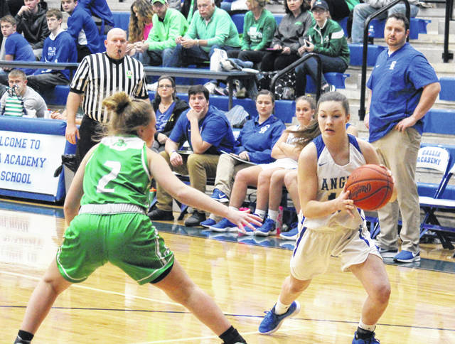 Gallia Academy freshman Preslee Reed (right) drives past Fairland's Harlie Lyons (2), during the Lady Dragons' 70-28 victory on Thursday in Centenary, Ohio.