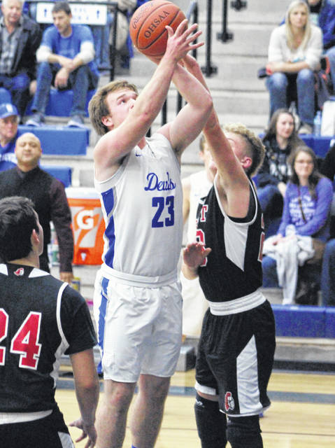 Gallia Academy junior Ben Cox (23) goes up for a shot attempt during the first half of a Jan. 5 boys basketball contest against Point Pleasant in Centenary, Ohio.