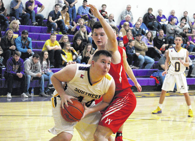 Southern's Arrow Drummer (left) works in the post against Wahama's Adam Groves (right), during the Tornadoes' 11-point win on Friday in Racine, Ohio.